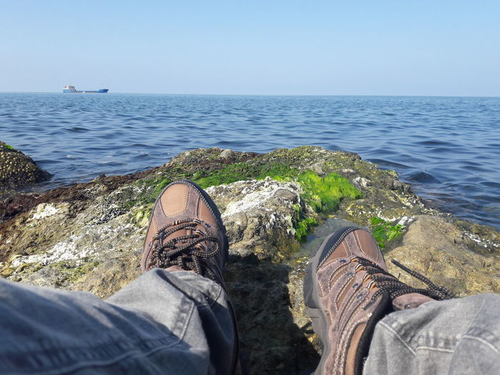Sea Personal Perspective Low Section Human Body Part Human Leg Beach Horizon Over Water One Person Water Shoe High Angle View Leisure Activity Nature People Lifestyles Day Relaxation Tranquility Looking At Camera UnderSea No People Making A Face Adult Outdoors Scenics
