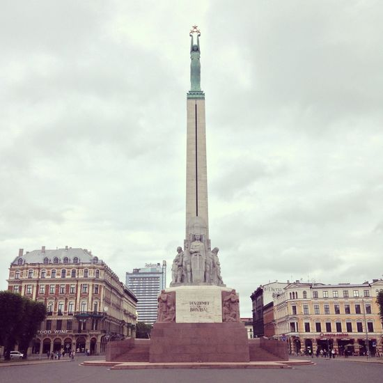 The Freedom Monument in Riga 1990s Architectural Column Architecture Baltic Baltic States Building Exterior Built Structure Capital Cities  City Cloudy Culture Famous Place Freedom Historic History Independence International Landmark Latvia Latvian Latvija Monument Post-soviet Riga Tourism Travel Destinations