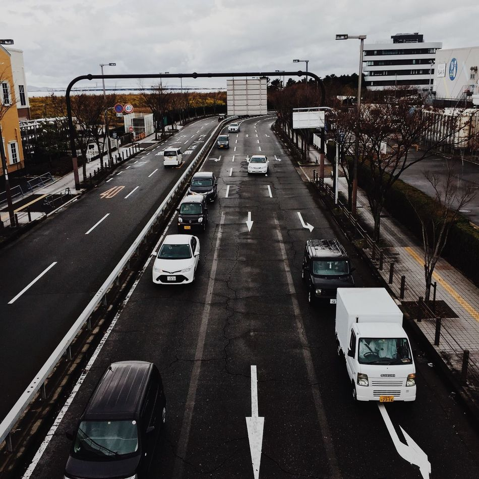 at peace Car Transportation Road Land Vehicle Traffic Mode Of Transport City Street Built Structure Architecture Day Outdoors Cloud - Sky Building Exterior Sky No People Japan Photography Japan City