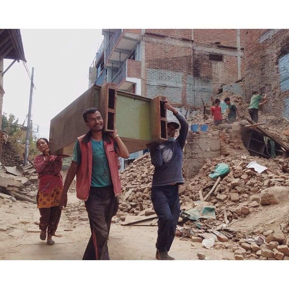 Bhaju Ratna Shakya (center) with his brother and sister in law, moving a steel cupboard from his elder brother Babu Ratna Shakya's home destroyed by the series of earthquakes, at Bungamati. As the number of aftershocks are decreasing each day, people have started to recover what remain of their belongings from their houses that were affected. Outofthephone Nepal Kathmandu Bungamati Earthquake Nepalearthquake Nepalphotoproject Instagramersoftheyear Instagramersoftheyear_nepal