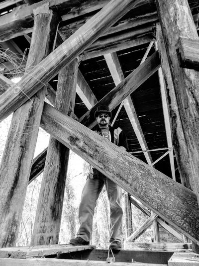 Built Structure Architecture Low Angle View One Person Day Outdoors Standing Real People Girder Portrait Only Men Men Adult Headwear One Man Only Sunglasses