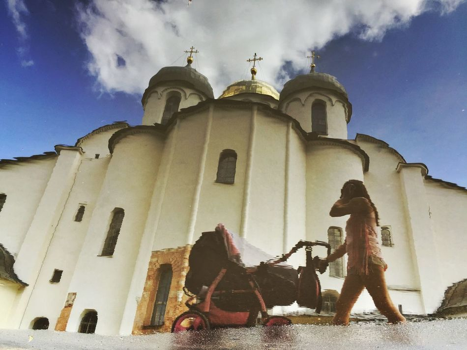 A woman pushes a pram past St Sophia Cathedral Water Reflections Rus2015tc Traveling Streetphotography Architecture Church