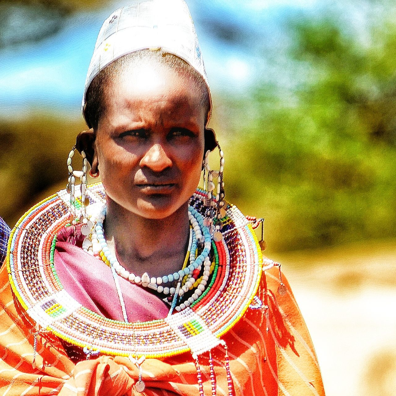 A Masai woman I was lucky enough to meet in the Serengeti, Tanzania. Real People Cultures Close-up One Person Africa Serengeti National Park African Masai Tanzania Faces Of The World Portrait EyeEmNewHere Travel Photography Travellife NOMAD Outdoors People Women Beautiful Woman Beautiful People Different Cultures Nikonphotography Travelgram Looking At Camera EyeEmNewHere Women Around The World
