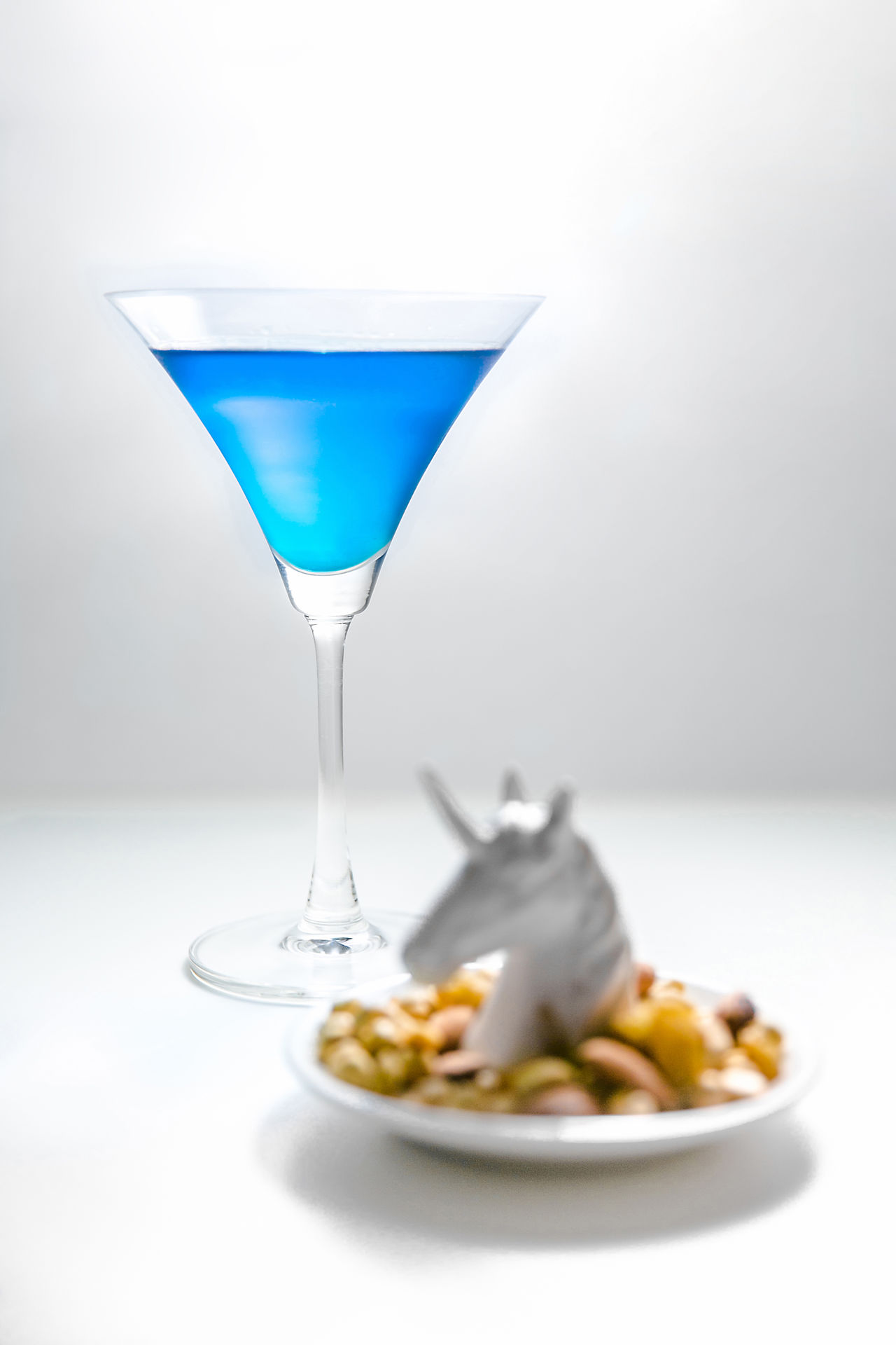 Alcohol Blue Close-up Cocktails Day Dinner Drinking Glass Food Food And Drink Martini Martini Glass No People Nuts Plate Unicorn White Background