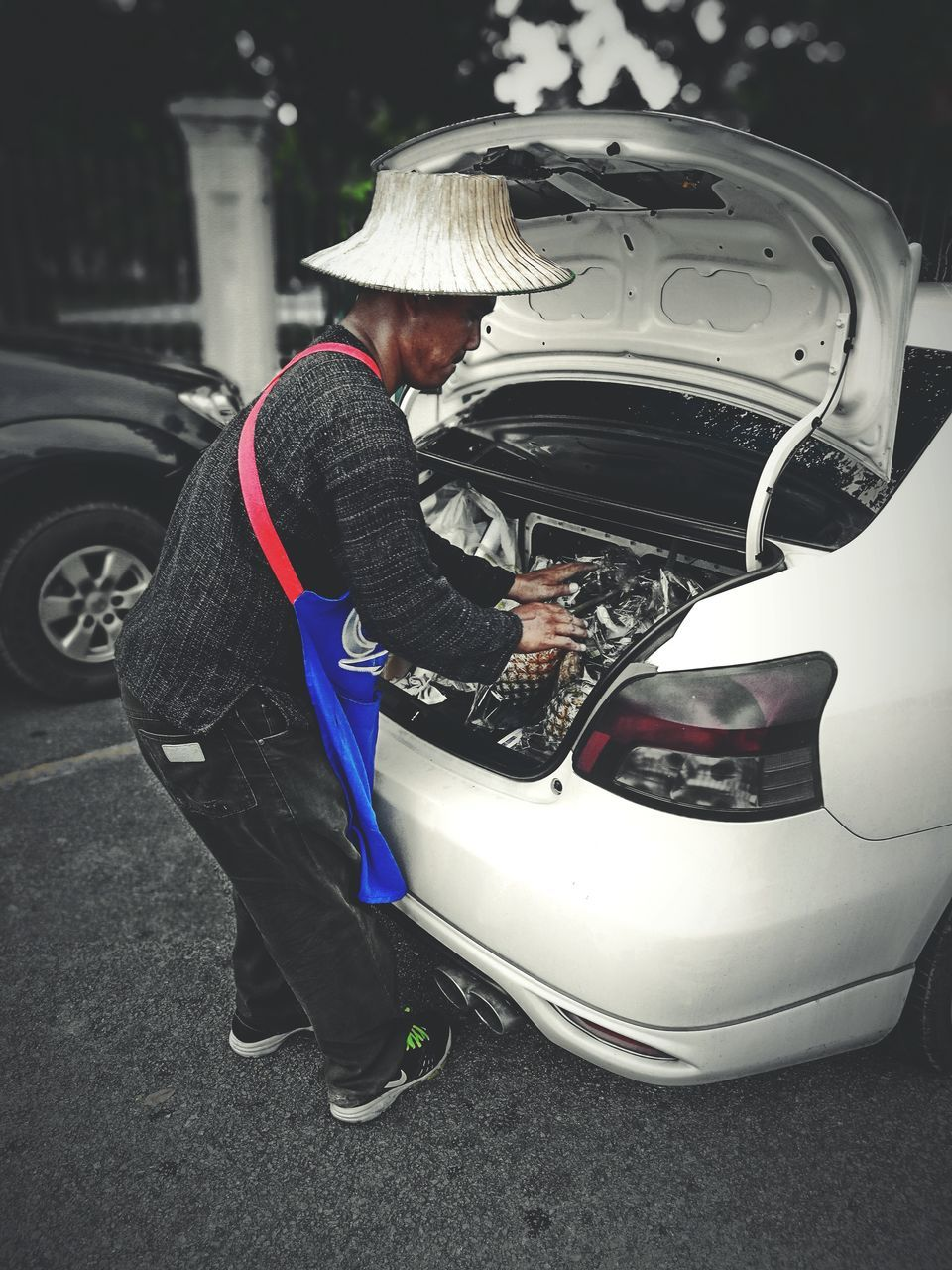 car, transportation, land vehicle, mode of transport, real people, men, one person, full length, repairing, mechanic, uniform, outdoors, day, auto repair shop, occupation, young adult, adult, people