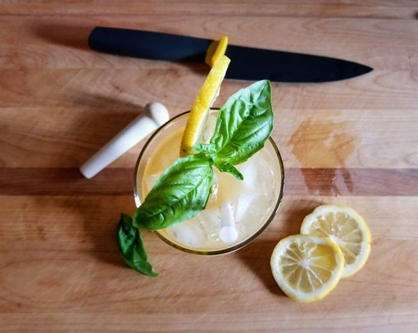 Food And Drink Indoors  Freshness Wood - Material No People Healthy Eating High Angle View Preparation  Citrus Fruit Directly Above Close-up Day Lemonaid Sliced Fruit Drink Basil Garnish Adult Knife Homemade Cocktail Summer Beverage Iced Thirst Quenching