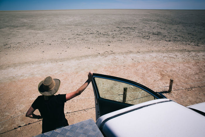 Road Trip Thru Namibia Africa African Beauty In Nature Cowboy Cowgirl Desert Door Dust Earth Idyllic Land Landscape Lifestyles Looking Open Pondering Relaxation Remote Road Road Trip Roadtrip Sand My Year My View Tranquil Scene Truck Long Goodbye The Secret Spaces