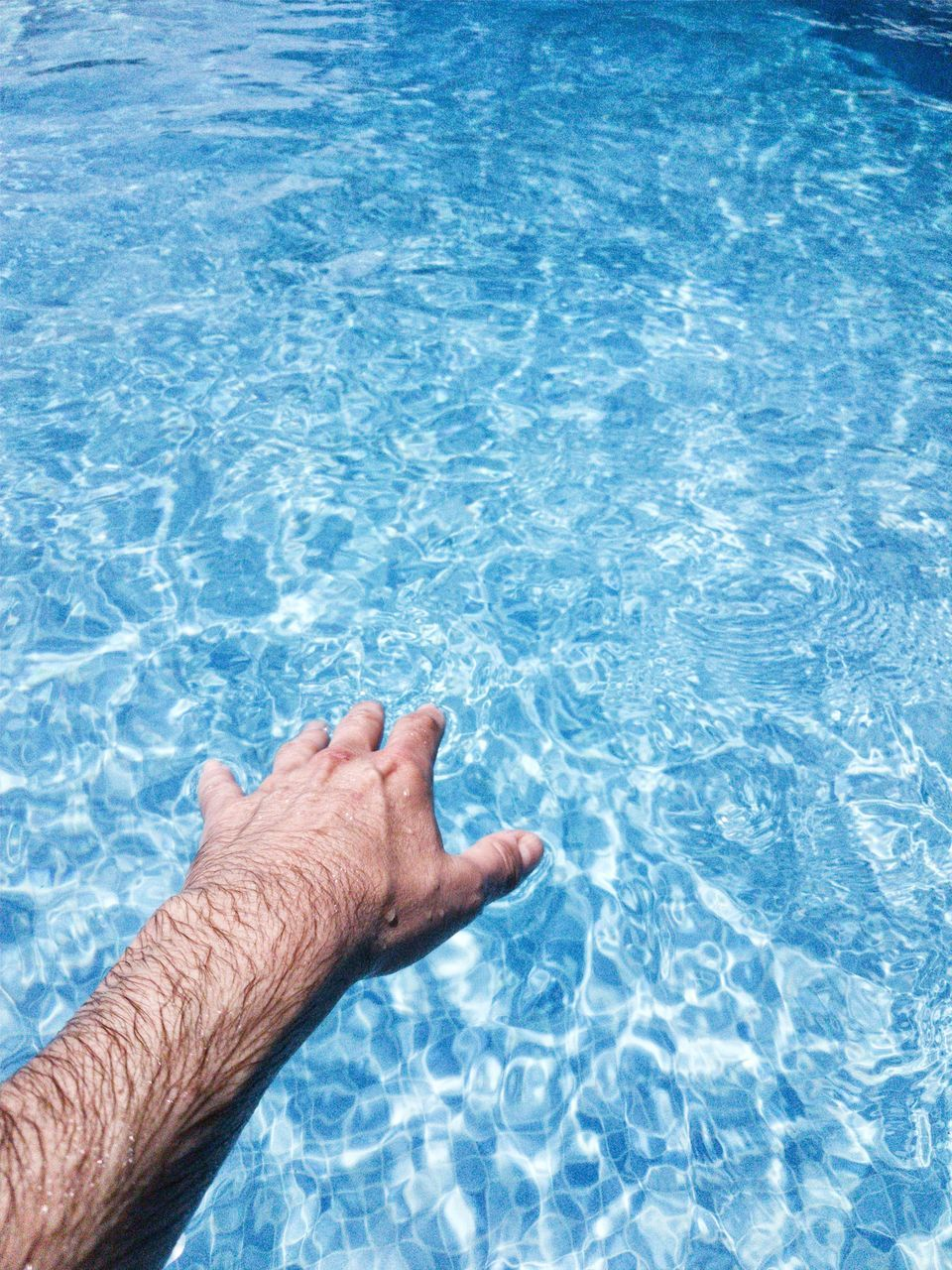swimming pool, water, human body part, one person, blue, rippled, summer, outdoors, day, one man only, human hand, people, low section, real people, close-up, refraction, adult, adults only, only men