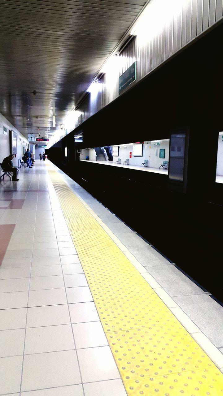People Waiting At Subway Station Platform