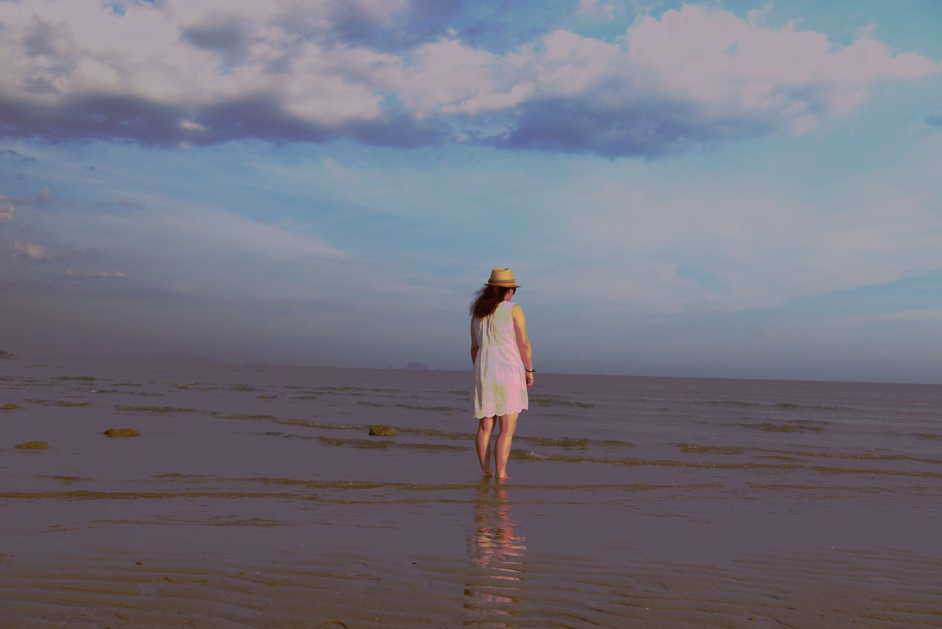 sea, water, sky, horizon over water, rear view, standing, beach, tranquility, lifestyles, leisure activity, tranquil scene, full length, person, scenics, shore, beauty in nature, nature, walking