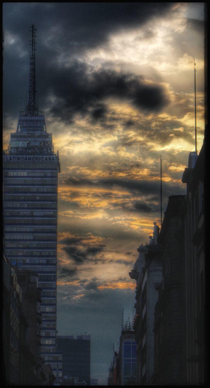 architecture, building exterior, built structure, cloud - sky, sky, sunset, city, no people, modern, skyscraper, flag, travel destinations, outdoors, storm cloud, nature, day