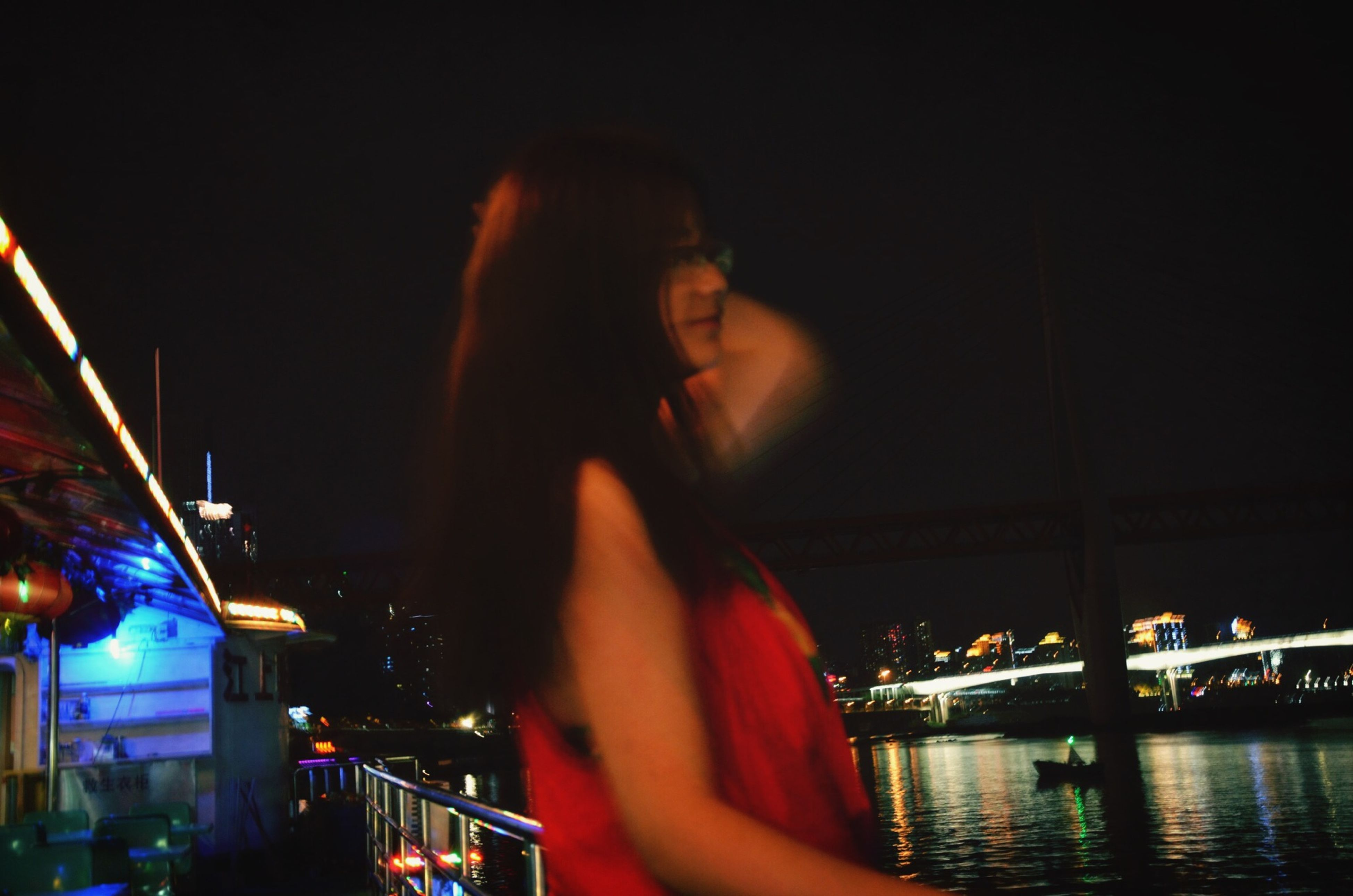 illuminated, night, lifestyles, leisure activity, young adult, architecture, building exterior, built structure, water, headshot, city, arts culture and entertainment, waist up, young women, reflection, standing, person, three quarter length
