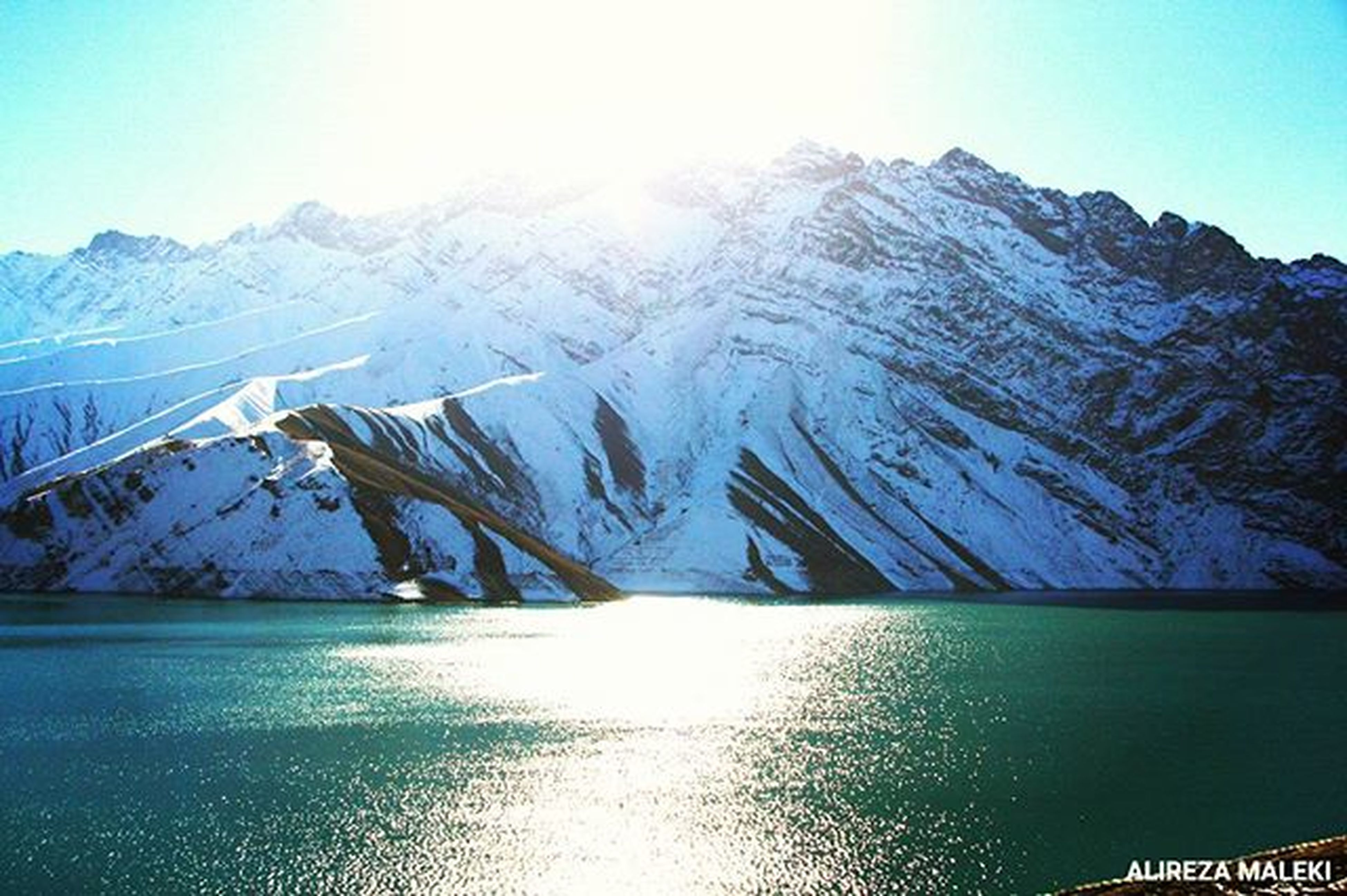 snow, winter, cold temperature, mountain, season, tranquil scene, snowcapped mountain, tranquility, mountain range, scenics, beauty in nature, water, weather, nature, frozen, lake, waterfront, covering, sky, idyllic