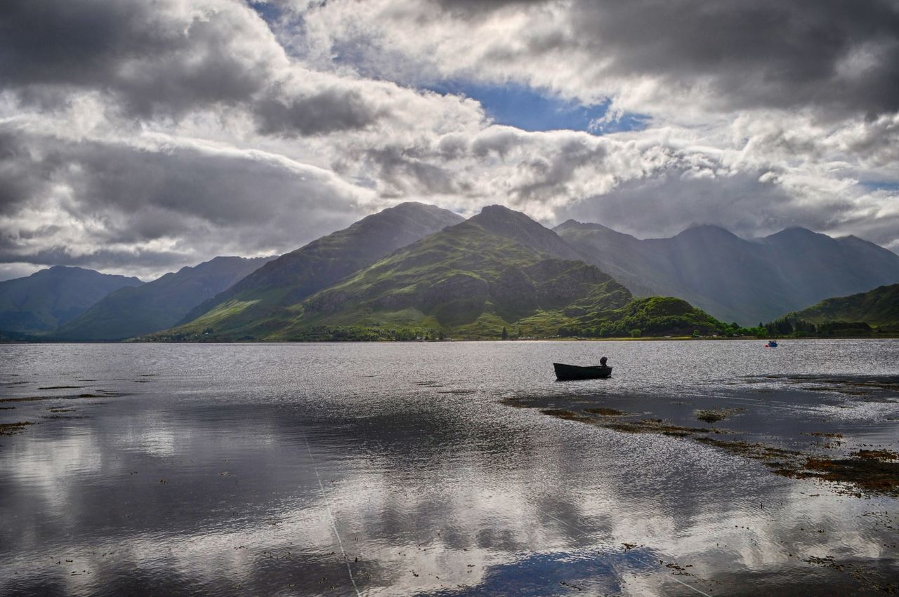 Ratagan, Loch Duich Beauty In Nature Blue Boat Cloudy Green Lake Lake And Boat Loch Duich Loch Duich In The Highlands Of Scotland Mirror Reflection Mountain Range Mountains Nature No People Ratagan Scotland Shore Sky Sky And Clouds Sky Cloud And. Sun Sun Tranquil Scene White