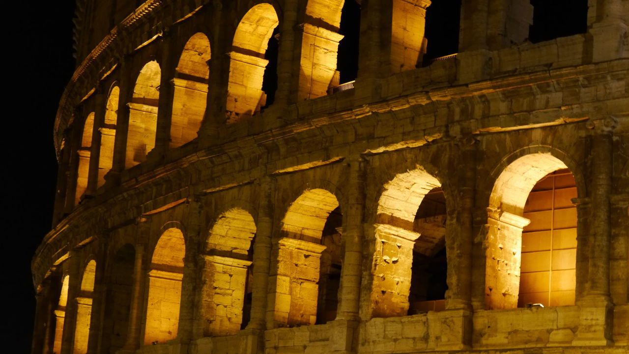Illuminated windows Architecture Travel Destinations Arch Tourism Night History Low Angle View No People Built Structure Warm Colors Light And Shadow EyeEm Gallery Eyem Gallery Illumination Part Of Building Colosseum Part Of Colosseum Rome The City Light Welcome To Black The Architect - 2017 EyeEm Awards Neighborhood Map Your Ticket To Europe