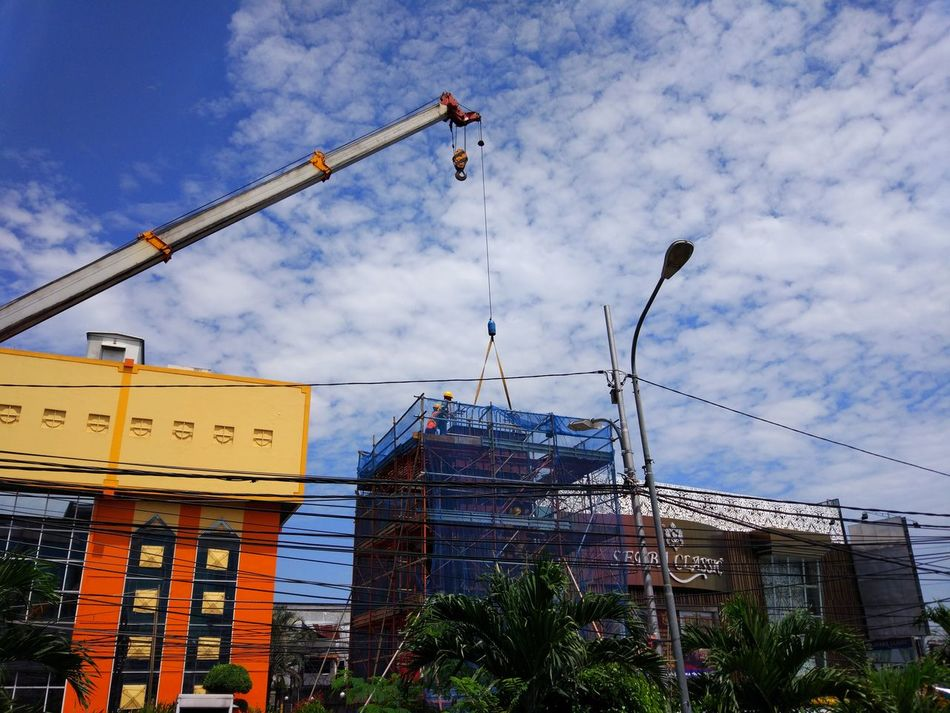 Beautiful Hot Day Somewhere In The World Tropical Dream Tropical Beauty Tropical Climate Construction Workers Blue Sky And White Clouds Building Exterior Built Structure Sky Architecture No People Low Angle View Cloud - Sky Outdoors City Day Nature JakartaStreet PlacesAroundEarth Somewhere I Remember Somewhere Over The Rainbow Street Photography Somewhere In My Island