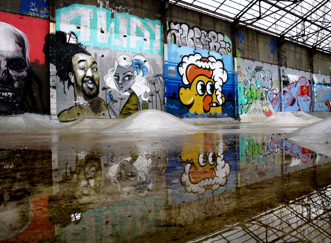 Architecture Art Art And Craft Built Structure Creativity Graffiti Multi Colored Mural Outdoors Reflection Street Art Wall - Building Feature