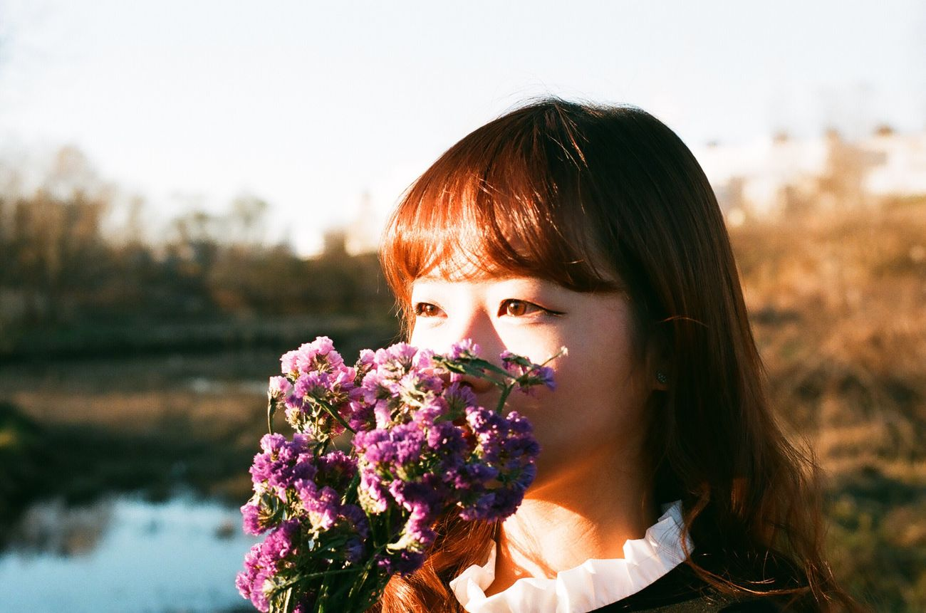 Flower Headshot Portrait Nature Outdoors Real People Beautiful Woman Lifestyles Leisure Activity One Person Close-up Bangs Young Women Beauty In Nature Freshness Day Bouquet Film Photography Filmisnotdead 35mm Film