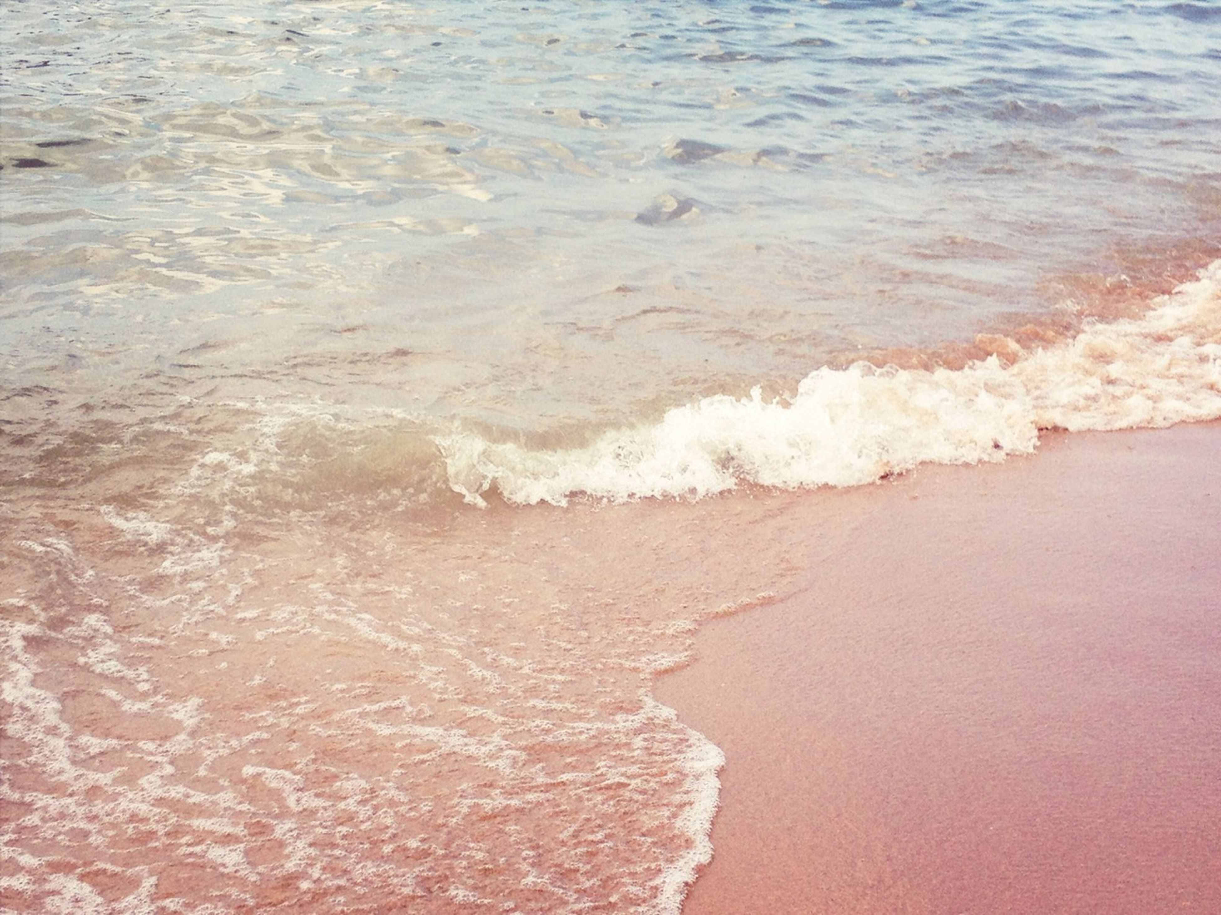 beach, sea, water, sand, shore, surf, wave, high angle view, nature, beauty in nature, horizon over water, motion, tranquility, scenics, coastline, outdoors, day, no people, tranquil scene, footprint