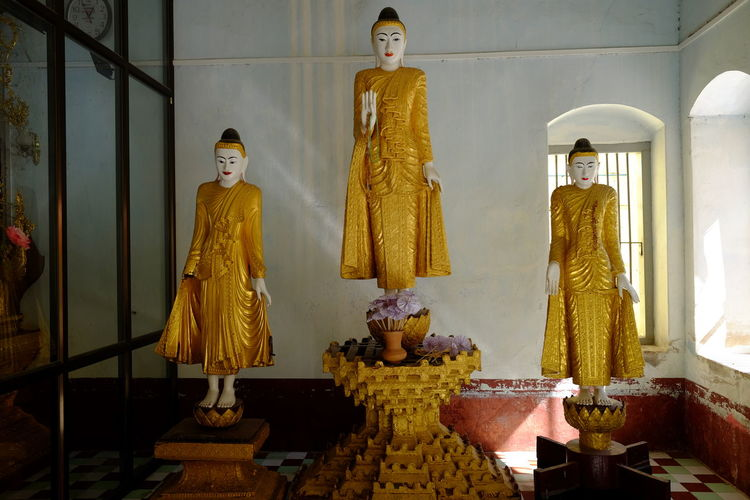 Three Buddhas at Kuang Mu Daw Pagoda Buddha Statues Buddhism Buddhist Pagoda Buddhist Symbol Buddhist Temple Composition Full Frame Gold Coloured Indoor Photography Kuang Mu Daw Pagoda Mandalay Myanmar No People Pilgimage Place Of Prayer Place Of Worship Religion Sunlight And Shade Tourism Tourist Attraction  Tourist Destination Travel Travel Destinations Travel Photography