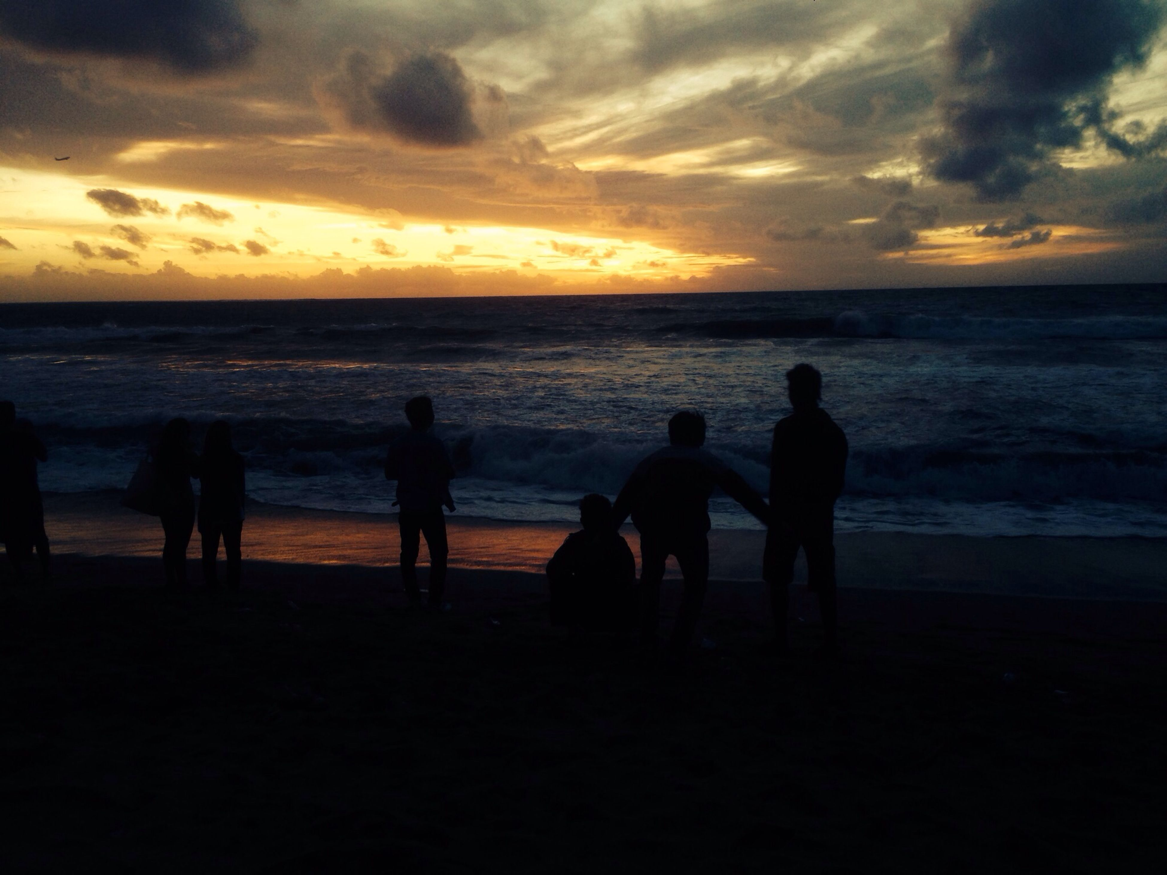 sea, sunset, water, horizon over water, sky, silhouette, beach, togetherness, leisure activity, men, lifestyles, shore, scenics, beauty in nature, cloud - sky, person, vacations, bonding, orange color