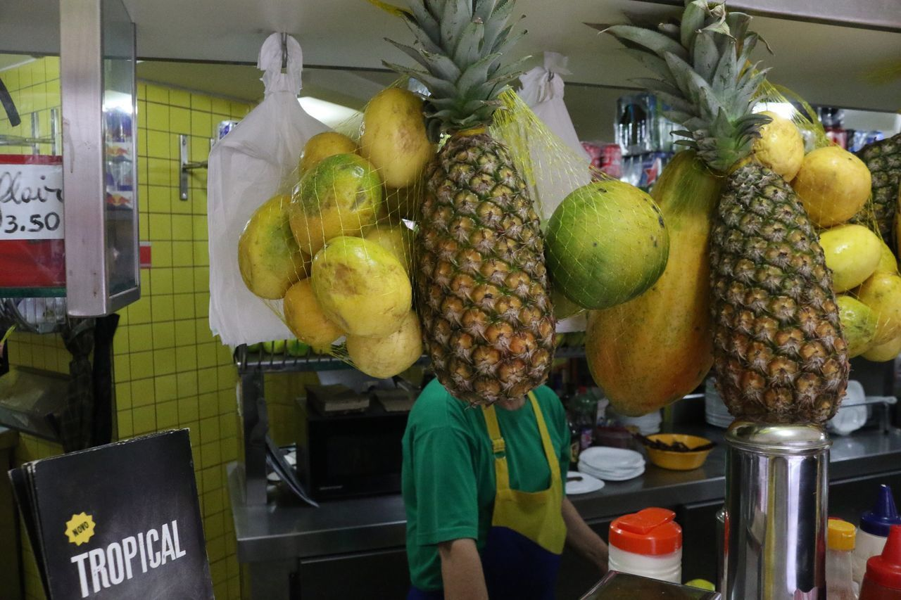 """""""Tropical"""". April, 2017 Streetphotography Saopaulo Saopaulocity Brazil Fruit Market Food Food And Drink Retail  Banana Freshness Small Business Healthy Eating Occupation Real People One Person Day Outdoors People Supermarket Butcher Adult"""