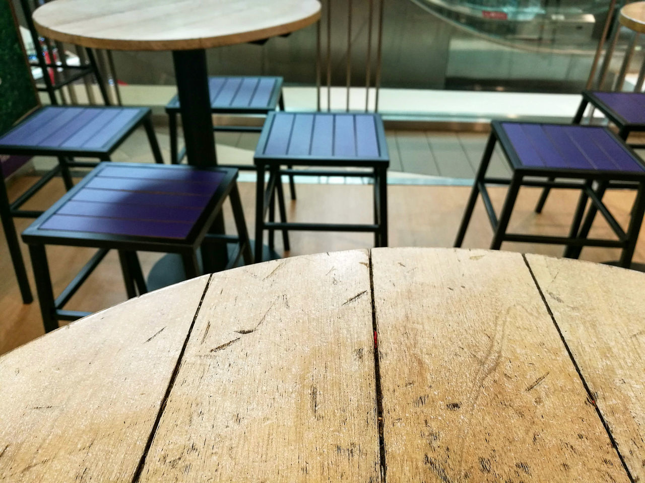 table, chair, focus on foreground, indoors, wood - material, no people, close-up, day