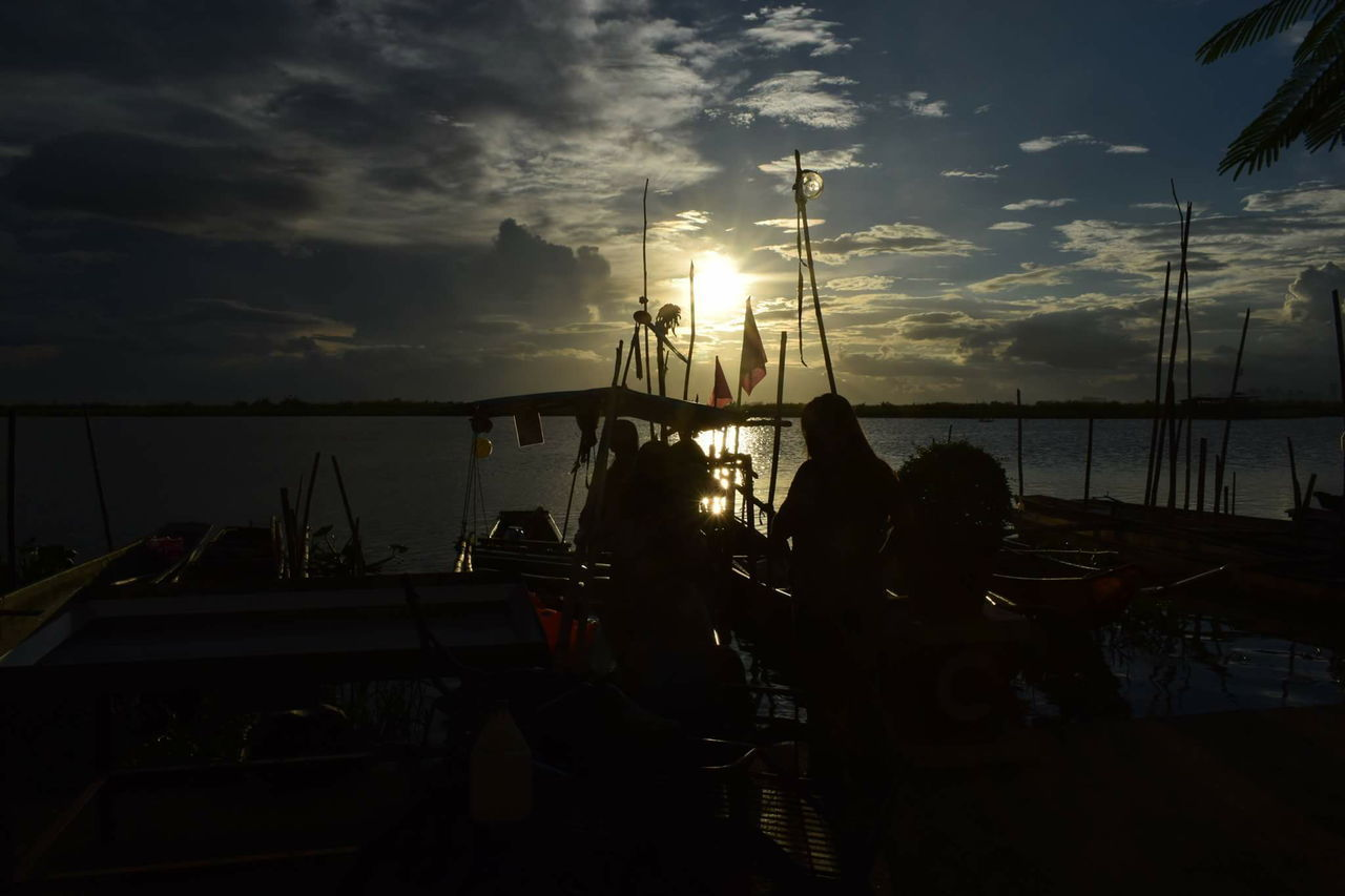 nautical vessel, sky, cloud - sky, transportation, mode of transport, sunset, sea, silhouette, nature, moored, togetherness, men, sun, real people, leisure activity, outdoors, water, beach, group of people, women, sailboat, scenics, beauty in nature, mast, friendship, day, people