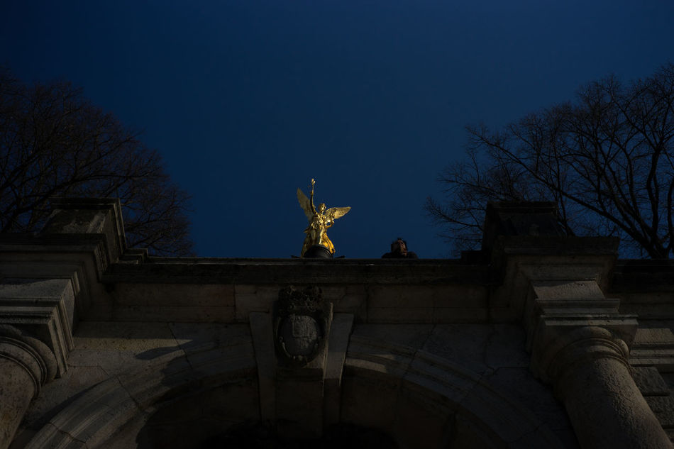 Weekend City - Golden Angel Architecture Art And Craft Bare Tree Bavaria Building Exterior Built Structure City City City Gate Illuminated Low Angle View Night No People Outdoors Sculpture Sky Statue Travel Travel Destinations Tree
