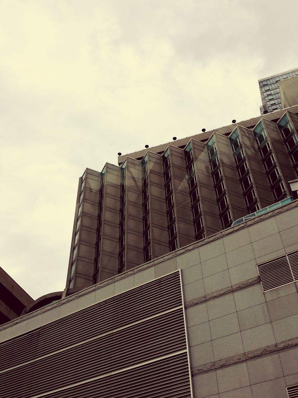 architecture, building exterior, built structure, low angle view, sky, no people, day, outdoors, cloud - sky, city