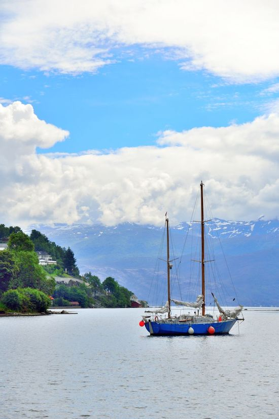 Blue sailboat in Nordheimsund, Norway. Beauty In Nature Blue Cloud - Sky Day Mode Of Transport Nature Nautical Vessel Nordheimsund Outdoors Sailboat Sailing Sailing Ship Sea Sky Transportation Travel Tree Vacations Water Yachting