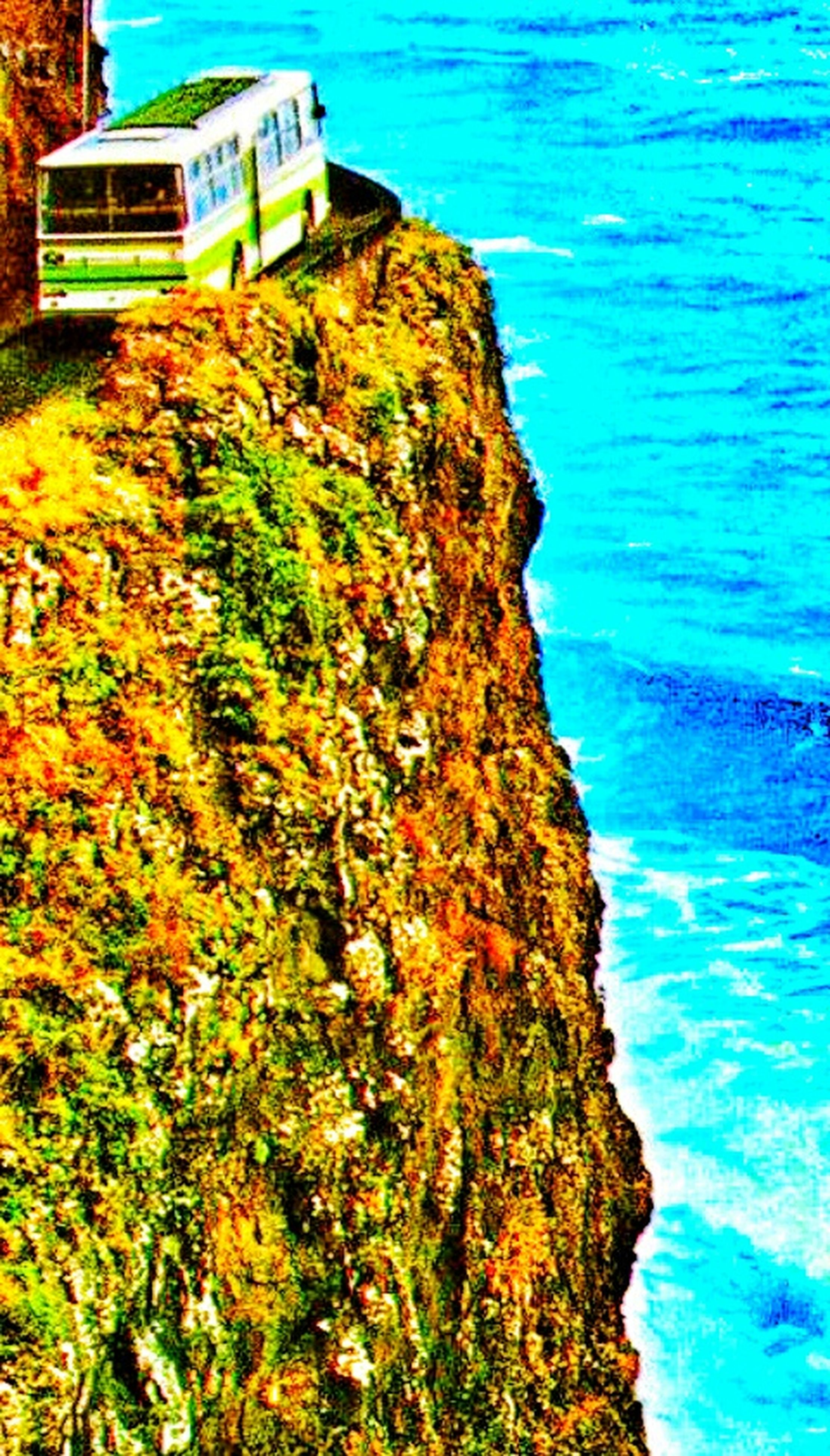 water, blue, sea, high angle view, nature, rock - object, turquoise colored, beauty in nature, tranquility, day, no people, outdoors, waterfront, rippled, rock formation, built structure, tranquil scene, scenics, sunlight, building exterior
