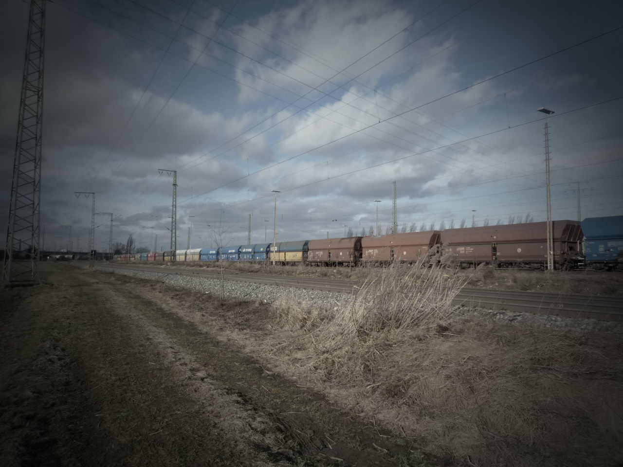 sky, transportation, rail transportation, cloud - sky, no people, train - vehicle, electricity pylon, railroad track, day, outdoors, nature