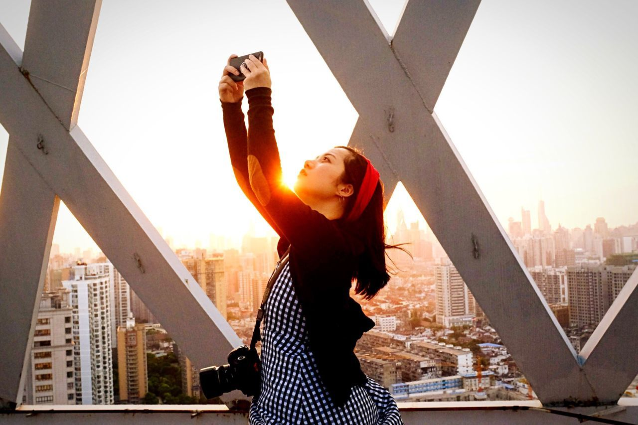 City Photography Themes Skyscraper Architecture Built Structure Cityscape Selfie One Person Building Exterior People Of EyeEm Girl Pretty Girl The Week Of Eyeem The Week On EyeEem Sunset_collection City Life Real People Young Adult Lifestyles Portable Information Device Young Women Leisure Activity Photo Messaging Camera - Photographic Equipment Wireless Technology