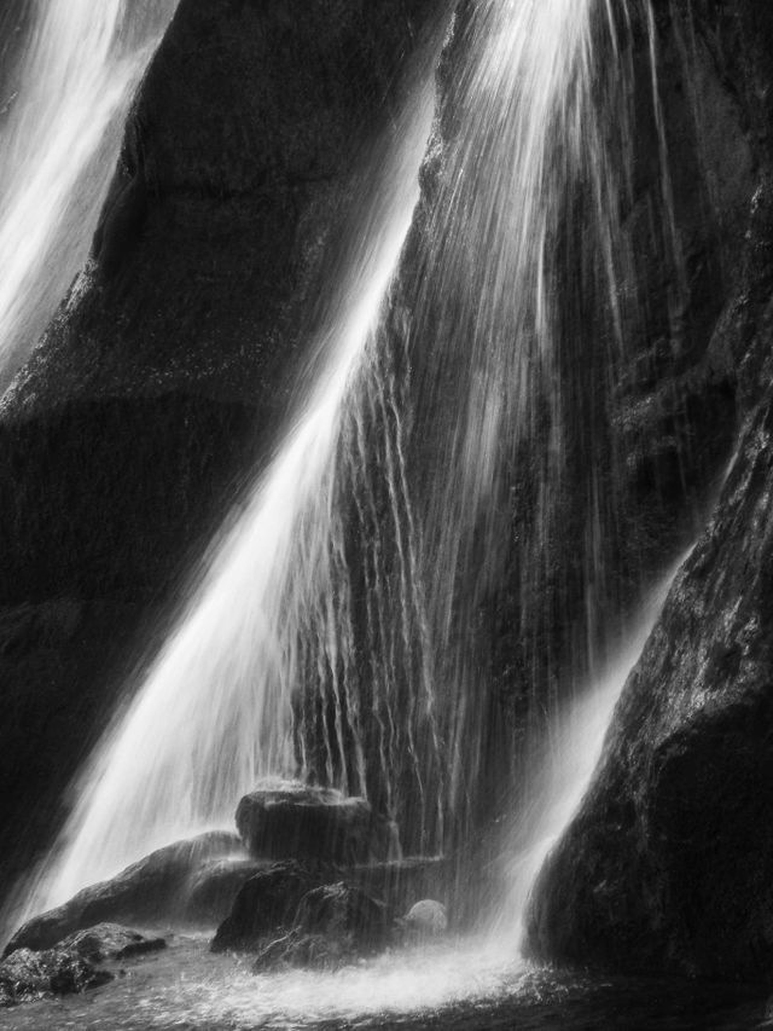 long exposure, motion, waterfall, flowing water, blurred motion, beauty in nature, scenics, nature, rock - object, low angle view, flowing, rock formation, forest, water, power in nature, tree, no people, tranquil scene, outdoors, speed