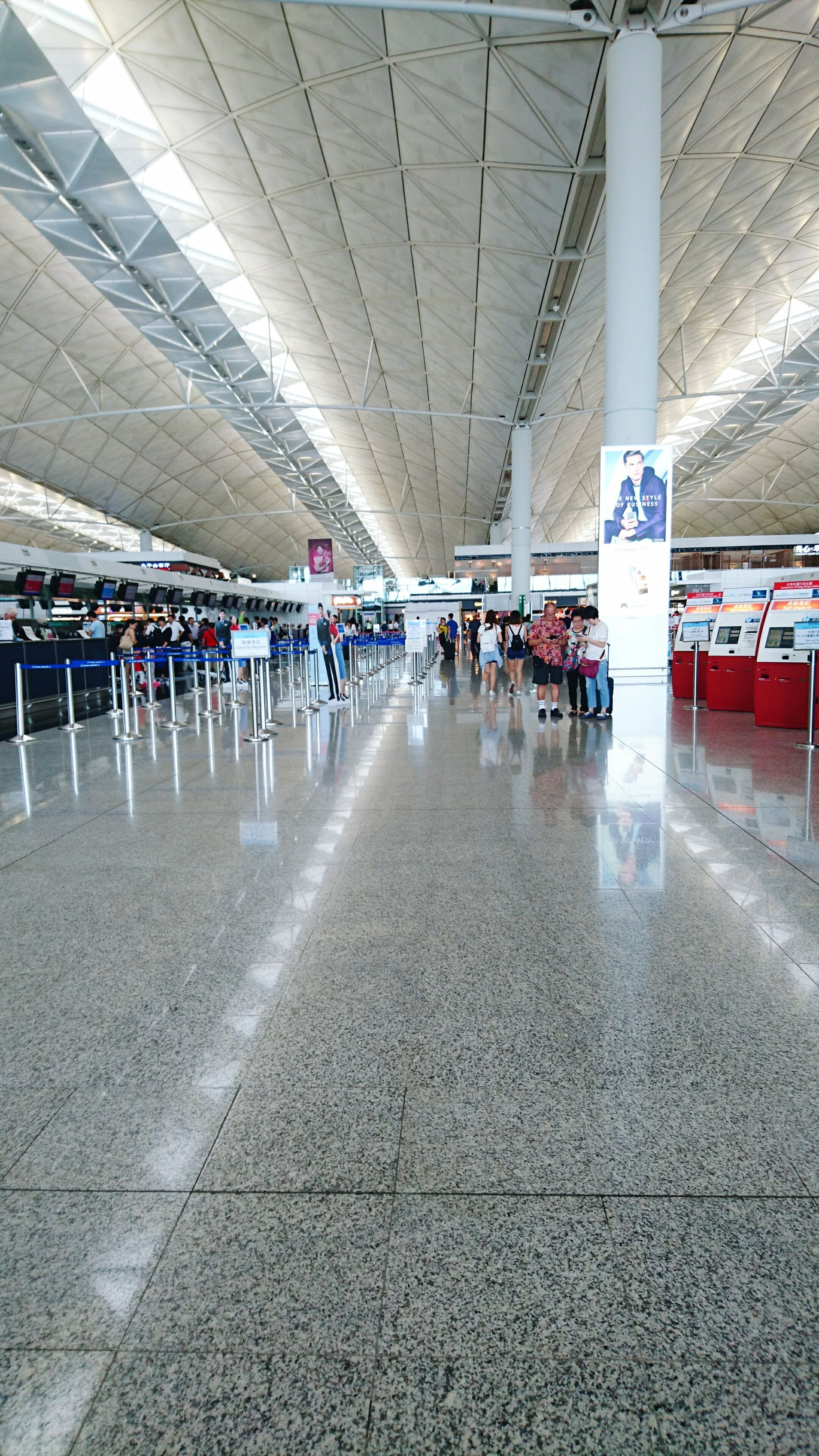 large group of people, transportation, built structure, architecture, indoors, architectural column, in a row, person, incidental people, travel, empty, men, flooring, the way forward, ceiling, city life, day, tiled floor, airport