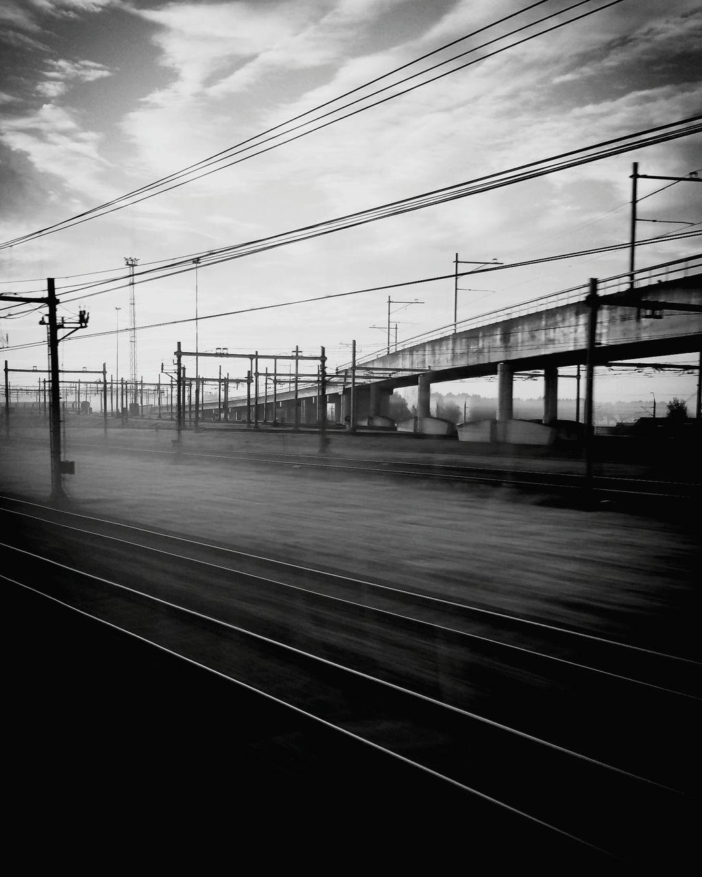 cable, rail transportation, transportation, sky, power line, connection, railroad track, public transportation, train - vehicle, no people, electricity pylon, day, outdoors, parallel, technology, nature