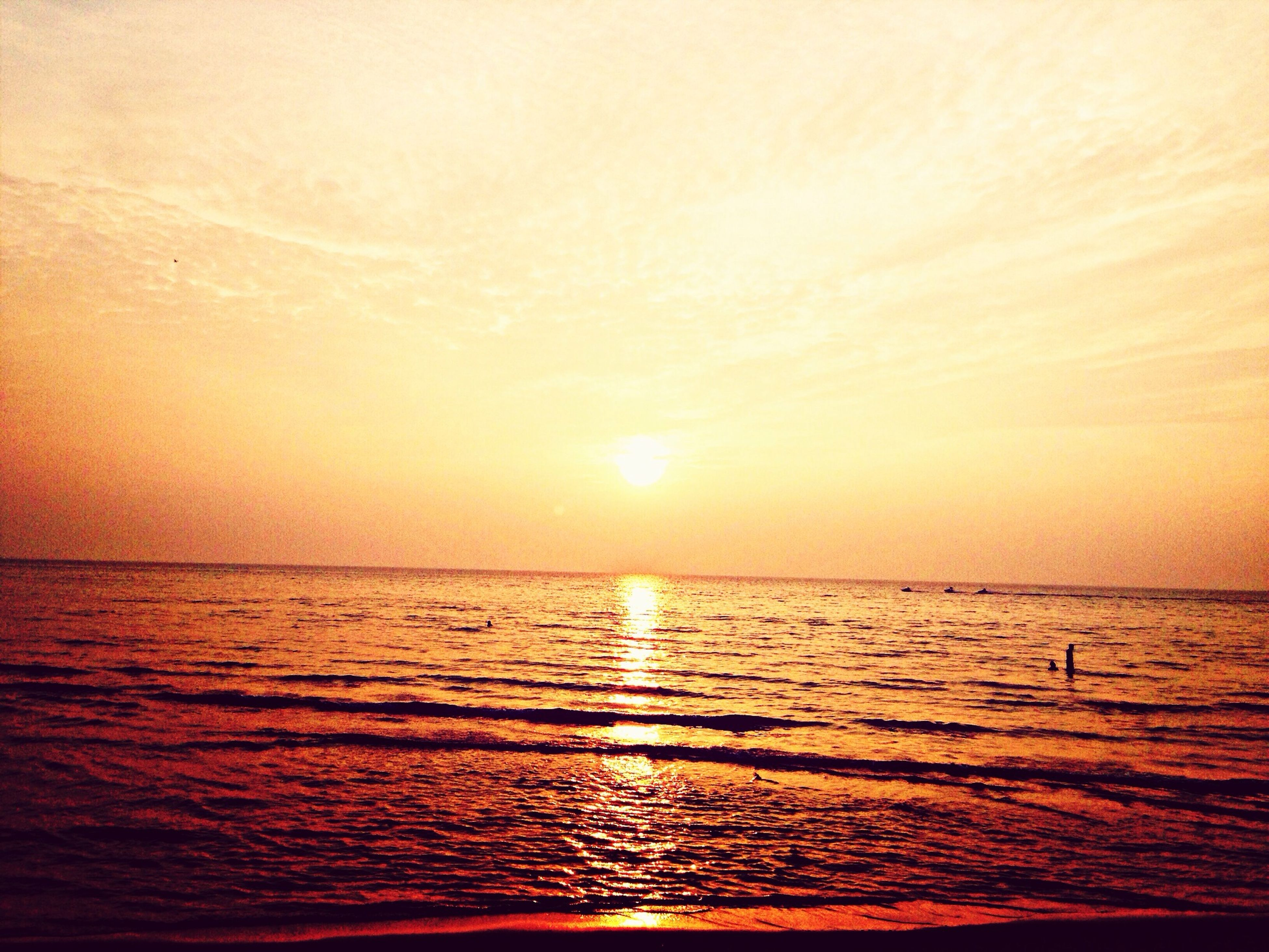 water, sunset, sea, tranquil scene, scenics, horizon over water, tranquility, beauty in nature, orange color, waterfront, sun, reflection, rippled, idyllic, nature, sky, sunlight, beach, silhouette, outdoors