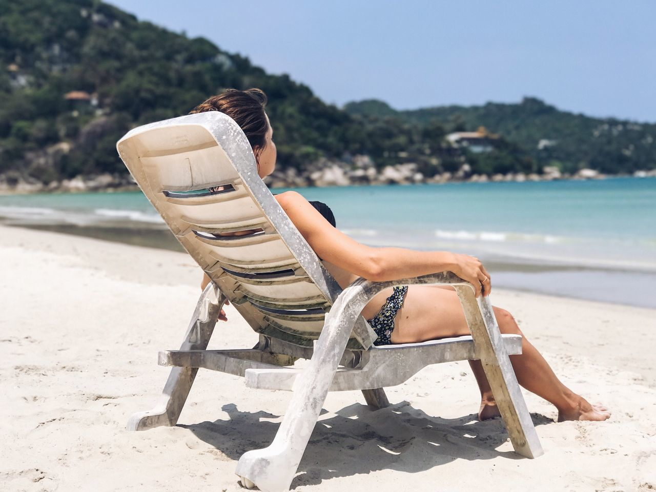 Beach Sand Sunlight Sea Relaxation Outdoors Day Sitting Nature One Person Chair Water Sky Real People Beauty In Nature Vacations Lifestyles Sunbathing Swimwear One Woman Only Rear View Thailand Tourist Young Adult People