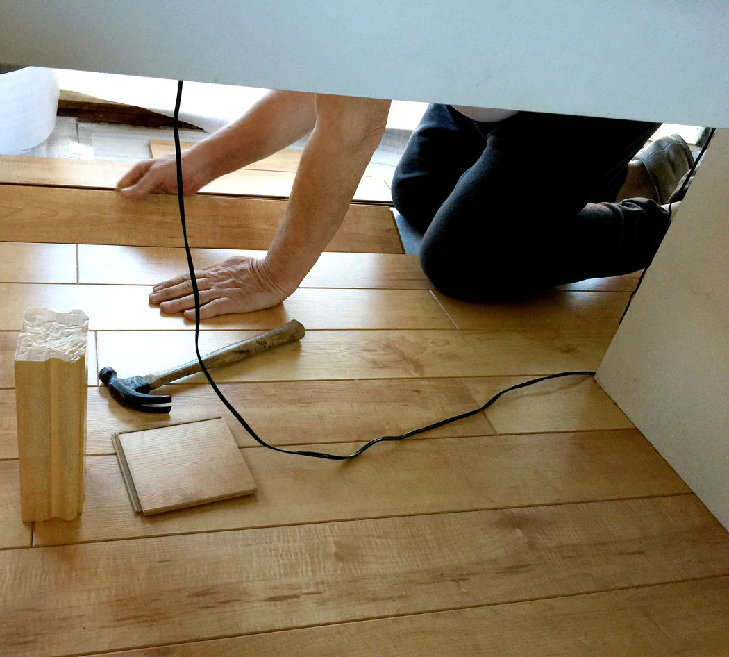 Homeowner on his knees installs new flooring. Copy Space Cord DIY Flooring Hammer Hands Home Improvements Home Interior Homeowners Human Leg Indoors  Installing Kneeling Laminate Man Real People Tools