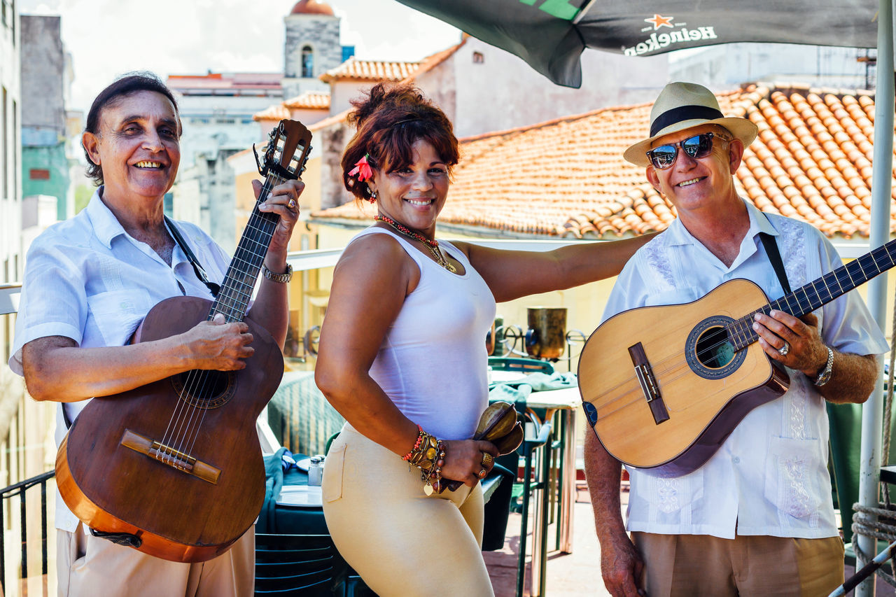 Adult Arts Culture And Entertainment Cheerful Cuba Collection Cuban Cultures Guitar Guitarist Happiness Hat Music Musical Instrument Musician Old Havana Outdoors People Performance Group Playing Plucking An Instrument Salsa Smiling Traveling