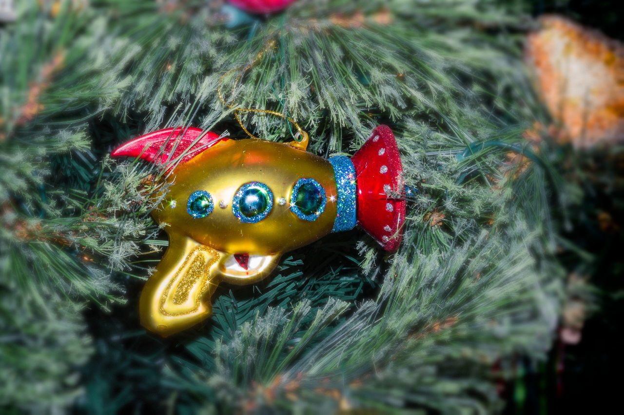 Cosmic Pistol Art And Craft Celebration Christmas Decorations Close-up Creativity Decor Focus On Foreground Green Color Holiday Holiday POV Man Made Object Mask - Disguise Multi Colored No People Ornaments Selective Focus Still Life Tradition