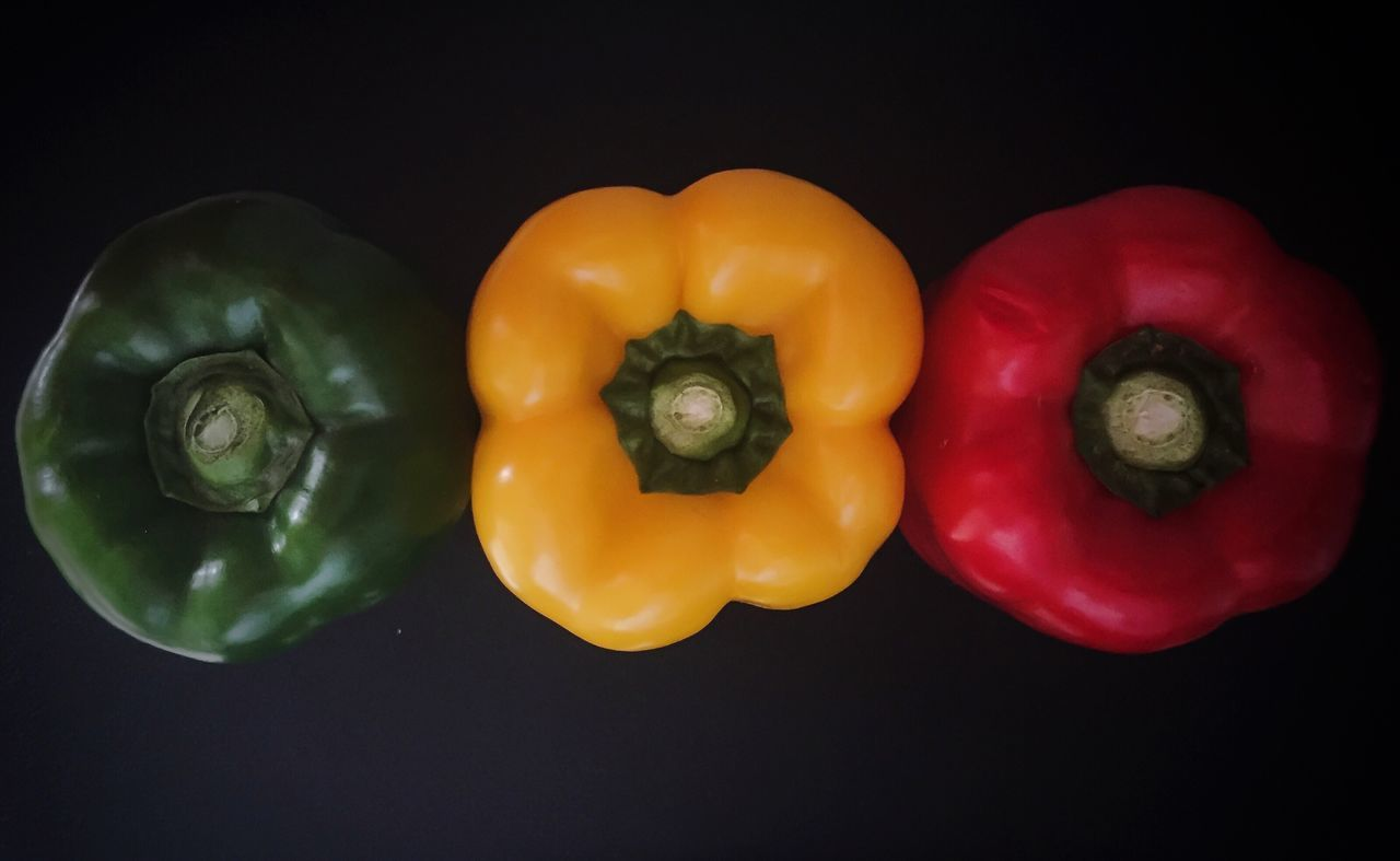 Freshness Healthy Eating Vegetable Food And Drink Studio Shot Food Directly Above Black Background Bell Pepper No People Close-up Red Bell Pepper Green Bell Pepper Yellow Bell Pepper Red Green Yellow Fresh Produce Freshness Three Healthy Healthy Food Cooking Capsicum
