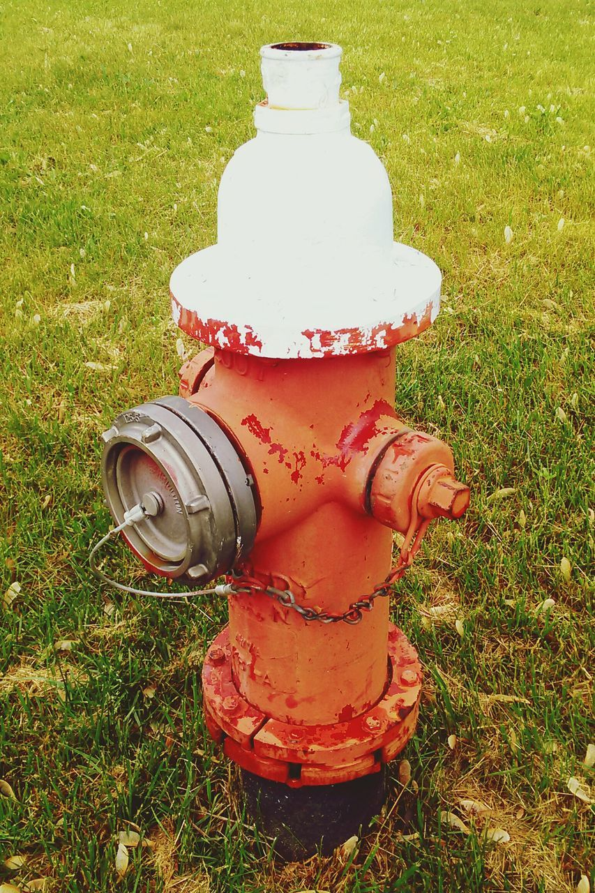 Fire Hydrant On Grassy Field