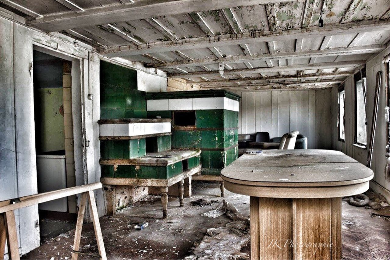 abandoned, indoors, domestic room, old-fashioned, wood - material, dirty, home interior, run-down, ceiling, damaged, architecture, no people, window, bad condition, unhygienic, rotting, day