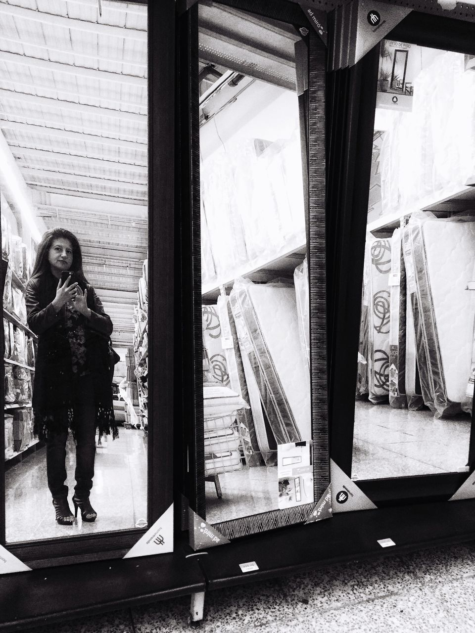 Reflection Of Woman Taking Selfie In Mirror At Departmental Store