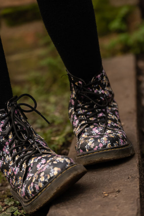 Balance Boots Casual Clothing Childs Footwear Creativity Cultures Dark Dr Martins Fashion Fashion Flower Pattern Flower Patterns Footwear Front View Kids Fashion  Laces Lifestyles Pathway Portrait Real People Standing Traditional Clothing