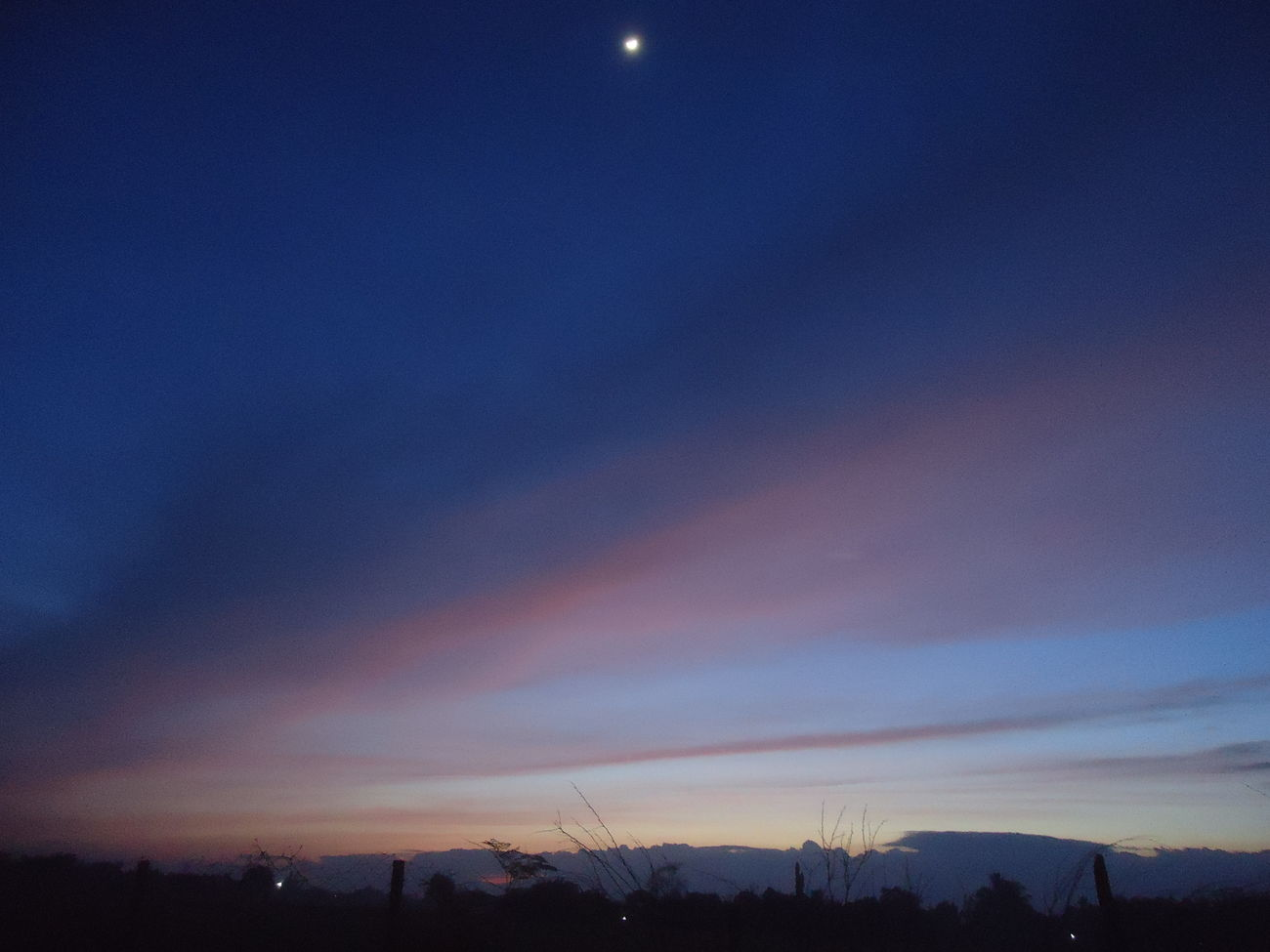 """So here's the story. My alarm woke me up at 4:10a.m. I did some stretching exercised activity and after that, I changed my pajamas into workout suit (as if, I have a proper suit for it, lol). Then, i checked the time and went outside if the sky was still dark. Until I saw this view for a minute. While looking at it, I said """"Sigh, am I looking at the front of both half night and day world?""""..."""