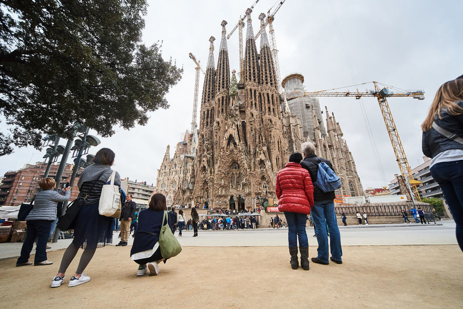 Barcelona, Spain - April 4, 2016: Sagrada Familia, is a large Roman Catholic church in Barcelona, designed by Spanish architect Antoni Gaudi. Unesco World Heritage Site. Spain Ancient Architecture Antoni Gaudí Barcelona, Spain Basilica City Construction Crane Construction Site Crowd Of People Editorial  Europe Famous Place Gothic Architecture Great History Landmark Monument Outdoors People Religious Architecture Roman Catholic Church Sagrada Familia Skyscraper SPAIN Travel Destinations UNESCO World Heritage Site