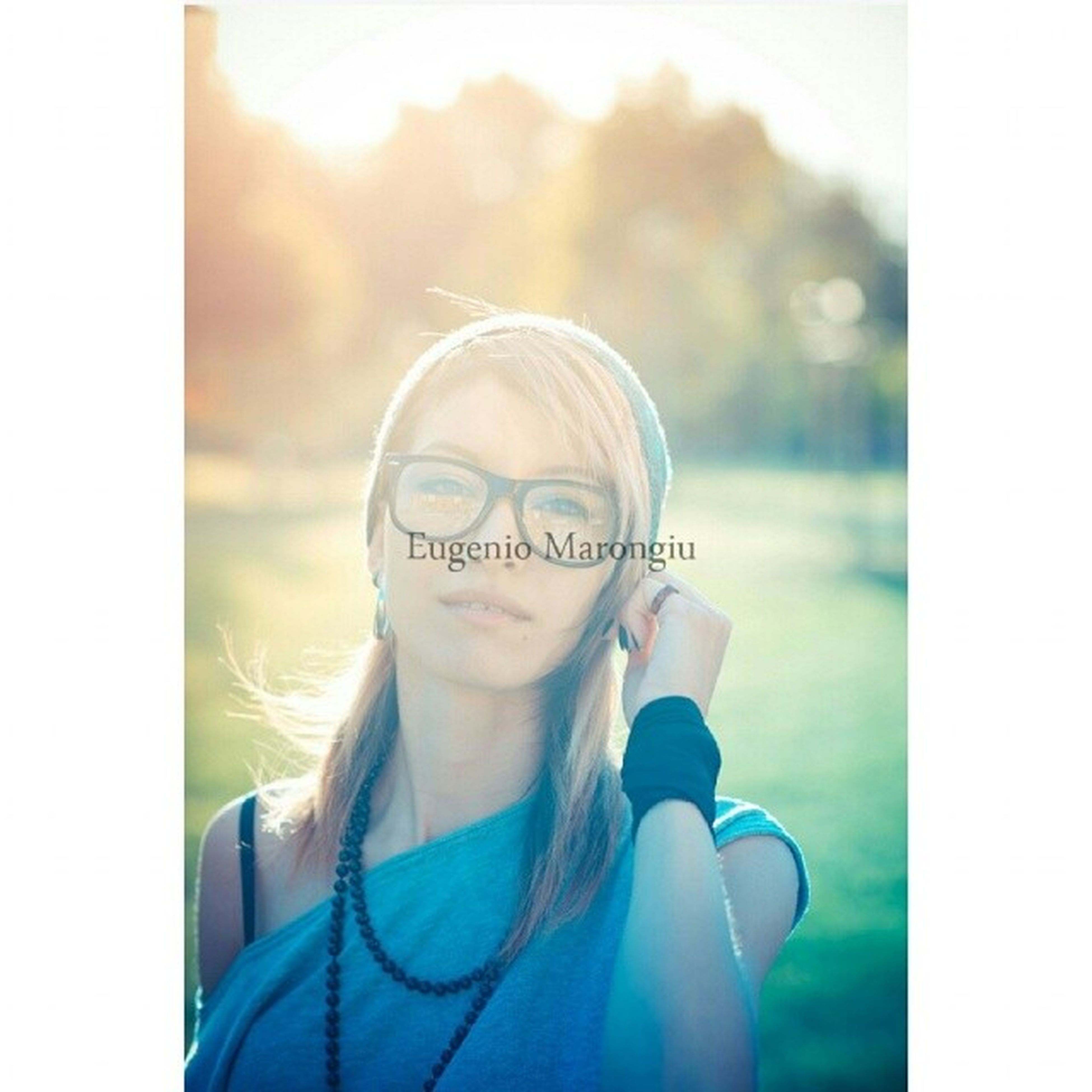 transfer print, headshot, lifestyles, young adult, looking at camera, person, auto post production filter, portrait, head and shoulders, leisure activity, front view, sunglasses, close-up, focus on foreground, young women, casual clothing, smiling